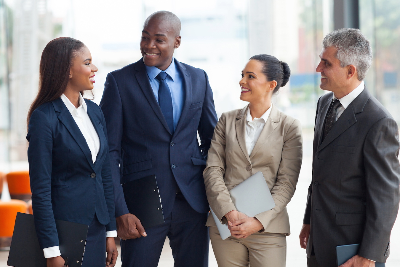diverse business group walking and talking