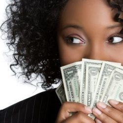 women holding dollar bills up to her face