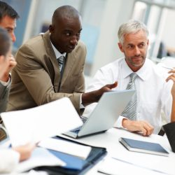 group of businesspeople in a team meeting