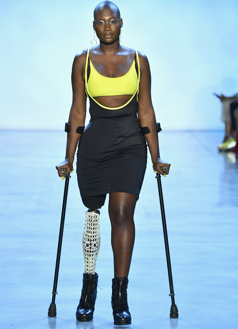 Mama Cax walks walks with crutches on runway after having right leg amputated