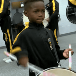5-Year-Old Drumming Prodigy marching in high school band playing his drums