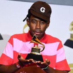Tyler the Creator holding a grammy award