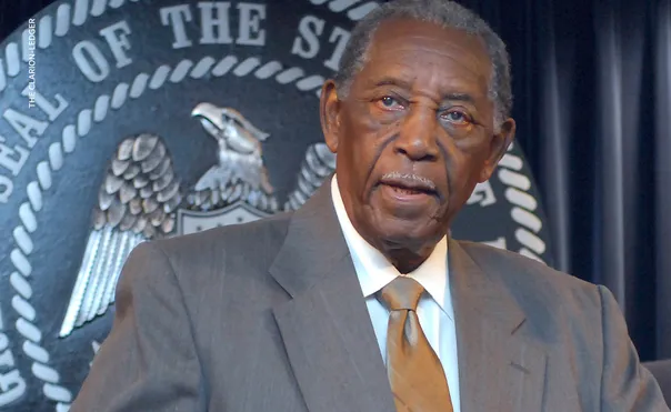 Charles Evers pictured with US seal in the background