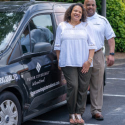 Mike & Daphne Williams stand outside in front of their work vehicle