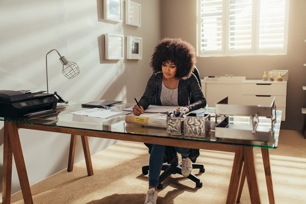 A woman working from home at a desk