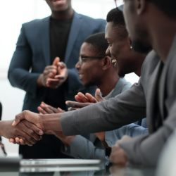 A group of men shaking hands and networking