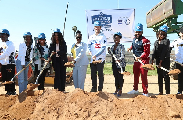 Anderson and group with shovels digging at the city of Compton Dodgers Dreamfields groundbreaking at Gonzales Park in Compton, California.