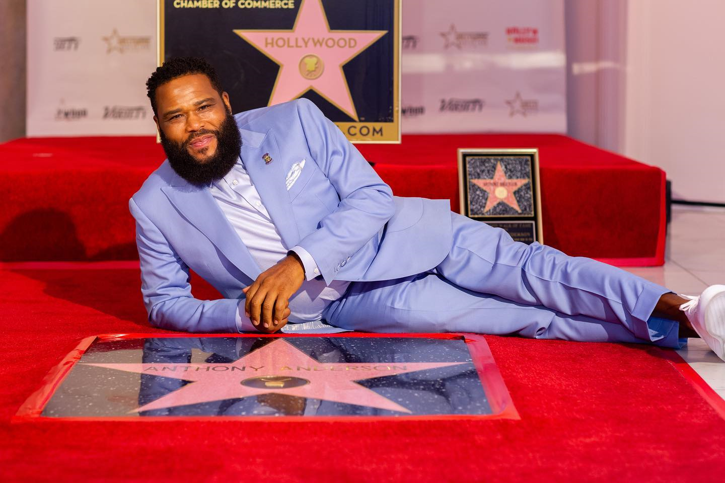 Anderson laying down in front of his star on The Hollywood Walk of Fame at the first-ever virtual ceremony at Historic Hollywood Museum