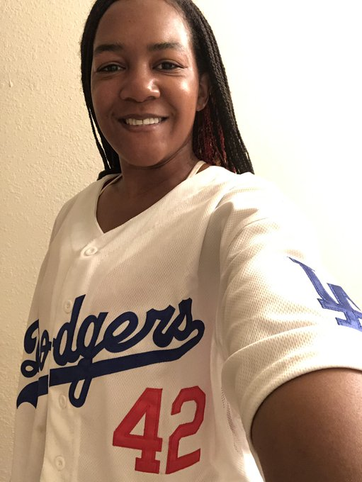 Bianca Smith smiles wearing a baseball jersey