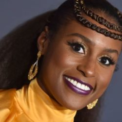Upclose picture of actress Issa Rae, wearing yellow, at an event