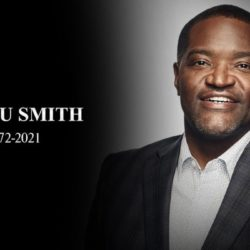 sekou smith wearing a suit black background with years of life