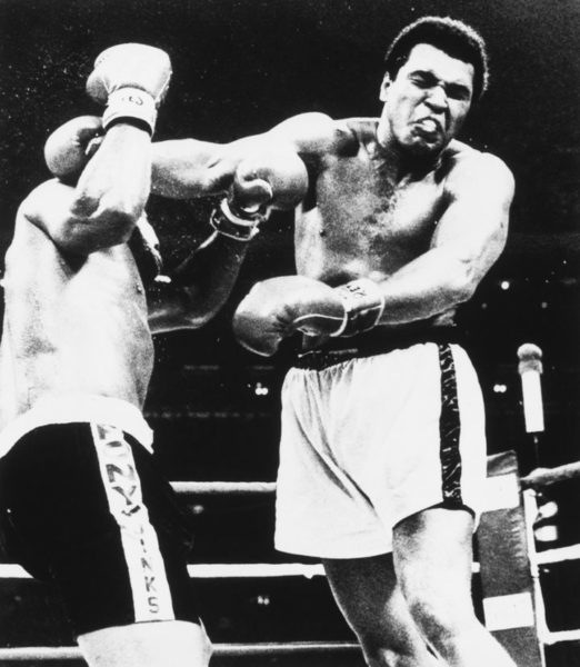 Mohamed Ali and Leon Spinks boxing fight in black and white