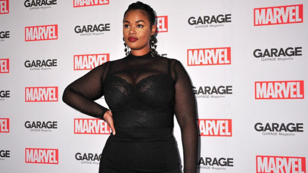 Precious Lee plus-sized model at a marver premier wearing a black bodycon dress
