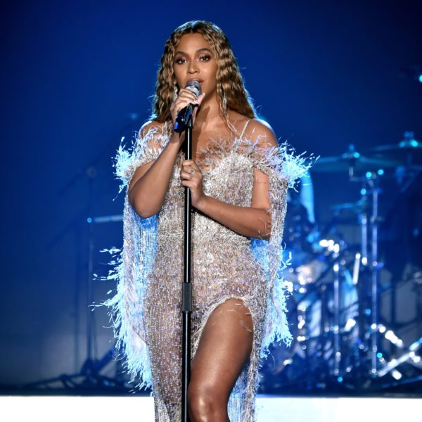 Beyonce performing in a rose gold off-the-shoulder gown with built in cape from Ralph and Russo's Fall 2018 couture collection
