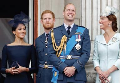 Meghan and Harry standing on veranda smiling with Prince William and Princess Kate in the foreground laughing
