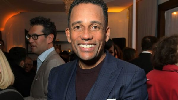 Hill Harper wearing a blue coat jacket and smiling at the camera while he attends the Netflix Golden Globe Weekend Cocktail Party at Cecconi's Restaurant