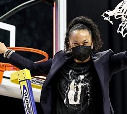 South Carolina head coach Dawn Staley celebrates after cutting the last piece of the net during the Elite Eight round of the NCAA Women's Basketball Tournament.
