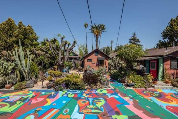 St. Elmo Village, an artists' enclave occupying a compound of 10 Craftsman bungalows, was founded in 1969 by artists Roderick and Rozzell Sykes as a place where children and adults could explore their creativity. The site is one of L.A.'s few designated landmarks linked to Black heritage.