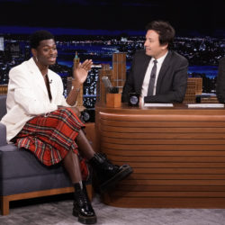 Lil Nas X seated on the set of Jimmy Fallon's talk show with special guest David Groll.