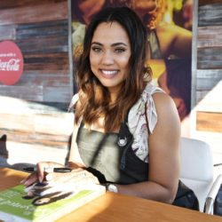 Ayesha Curry signs books at Goya Foods' Grand Tasting Village Featuring Mastercard Grand Tasting Tents & KitchenAid Culinary Demonstrations in Miami Beach, Fla., on Feb. 25, 2017.