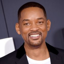 Will Smith smiling away from the camera